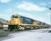 Road-switcher diesel locomotives with freight train.