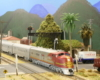 A red-and-silver Santa Fe diesel leads a streamlined passenger train through a California scene
