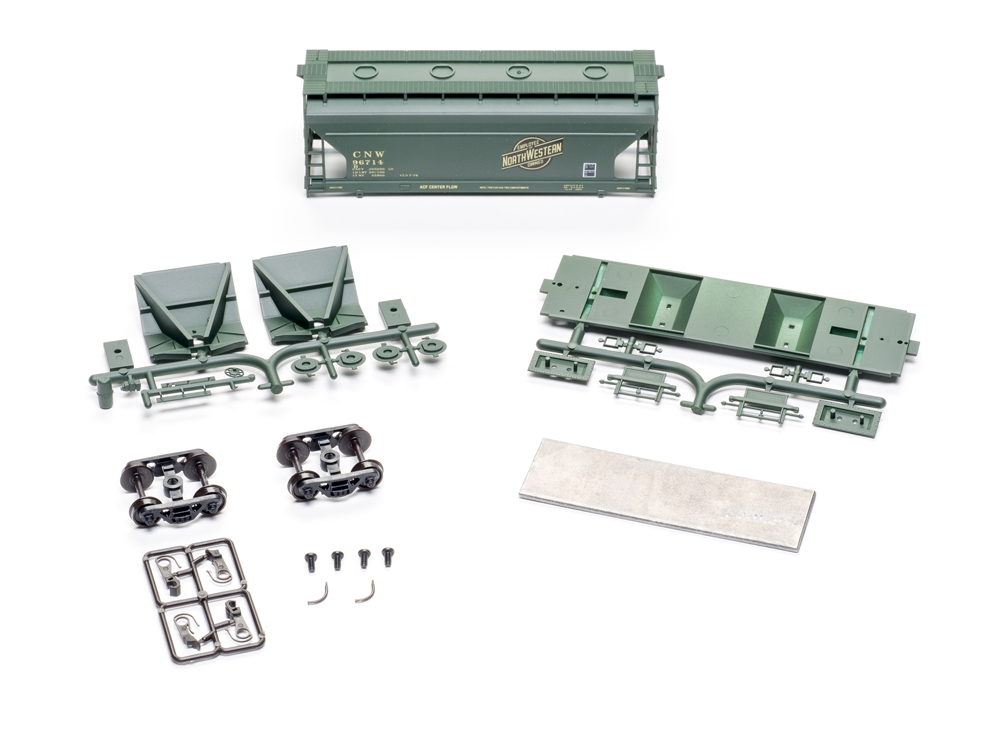 Accurail HO scale American Car & Foundry 2,970-cubic-foot-capacity two-bay Center Flow covered hopper kit contents.