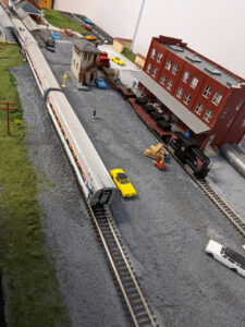 An industrial yard shows people at work