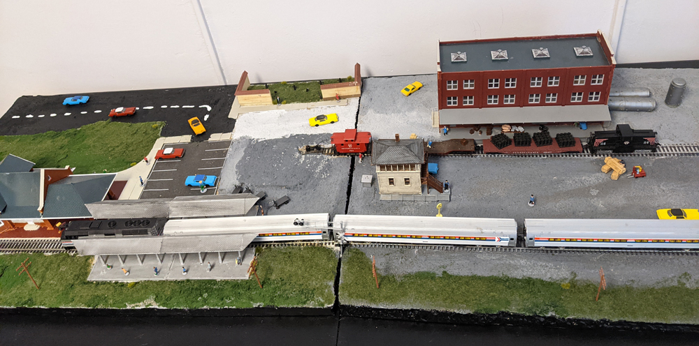 An overhead view of Mendolia's layout, which is a scene of an industrial area and passenger train station