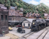 A weathered steam engine leads a train past a white clapboard station in an Appalachian town
