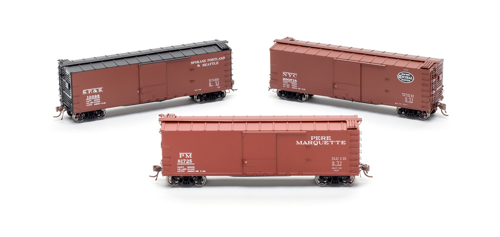 Three Rapido USRA double-sheathed 40-foot boxcars, clockwise from top left Spokane, Portland & Seattle; New York Central; and Pere Marquette