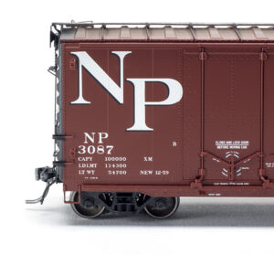 Close-up view of Tangent Scale Models HO scale Northern Pacific Pullman-Standard 40-foot combination-door boxcar.