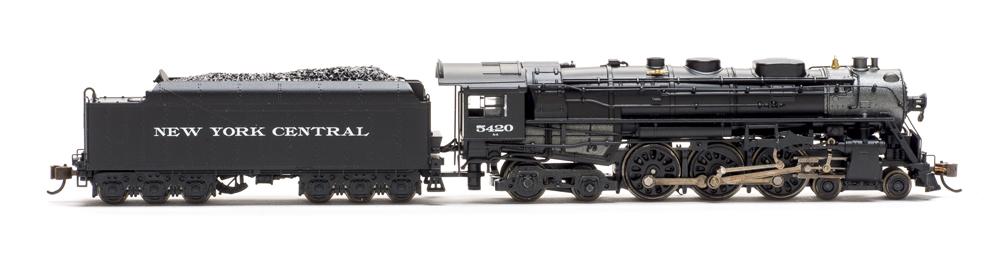 Bachmann locomotive pulling a coal car
