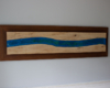 A hanging piece of wavy resin wall art.