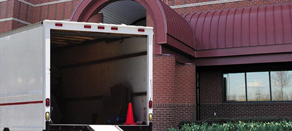 Open garage door with moving truck