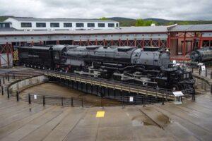 Steam locomotive and tender on turntable