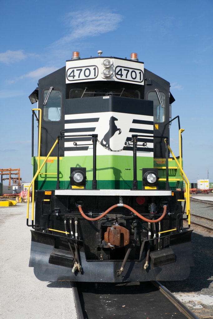 Front view of black and white Norfolk Southern locomotive
