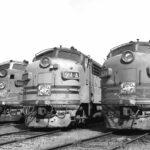 Black and white photo of three F unit locomotives in Stockton roundhouse