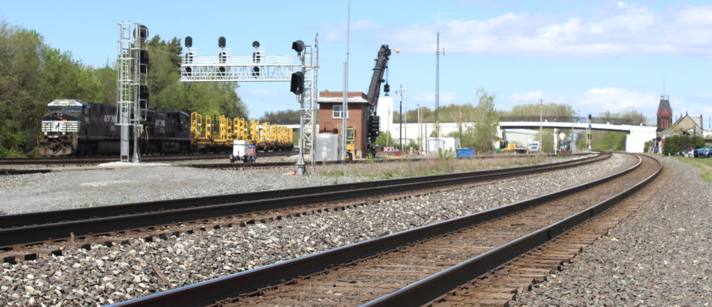 Black locomotives power freight train at junction
