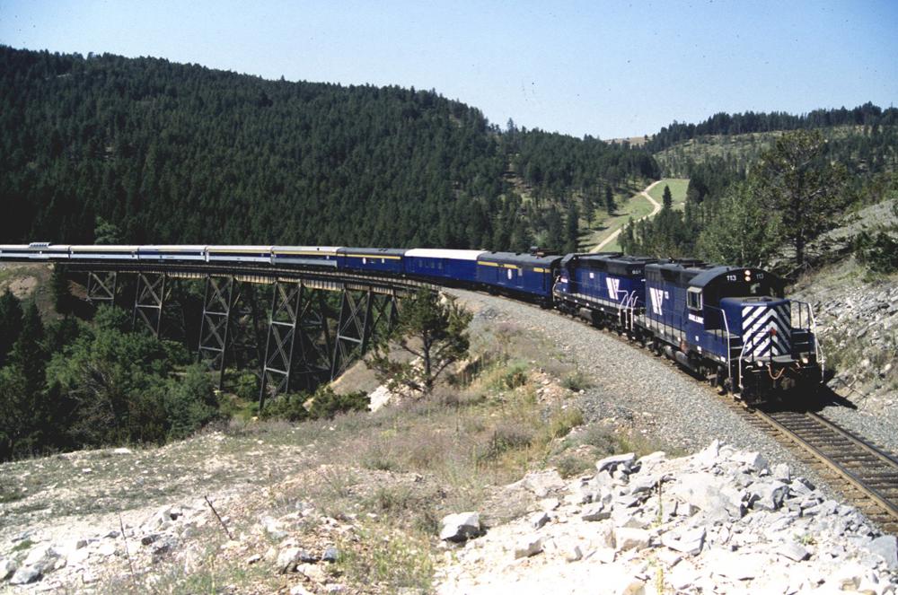 Passenger train curves over bridge