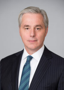 Head shot of gray-haired man in suit