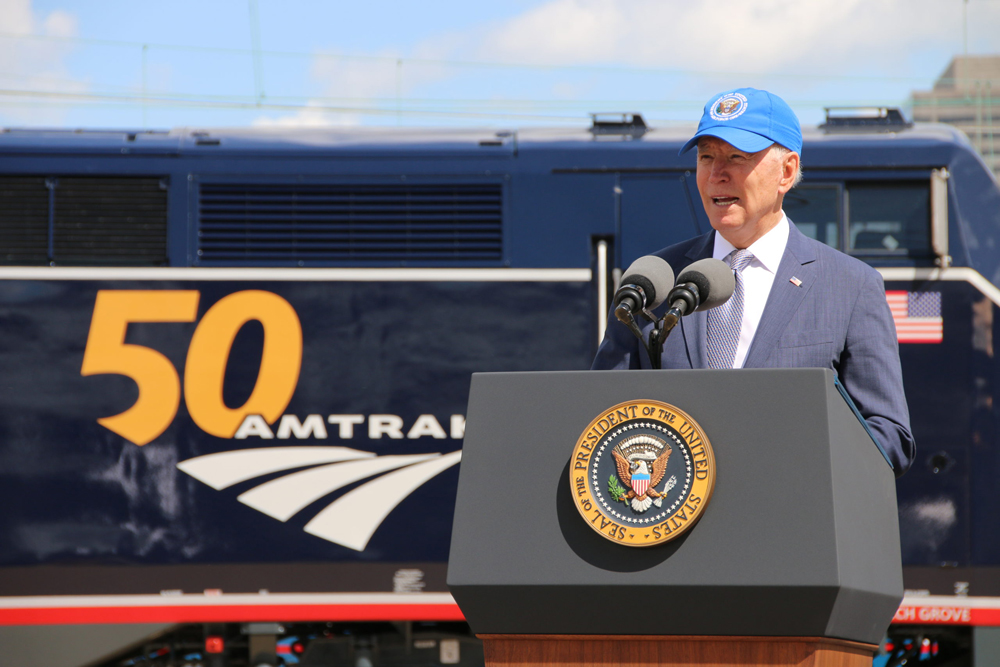 President Biden speaking in front of locomotive