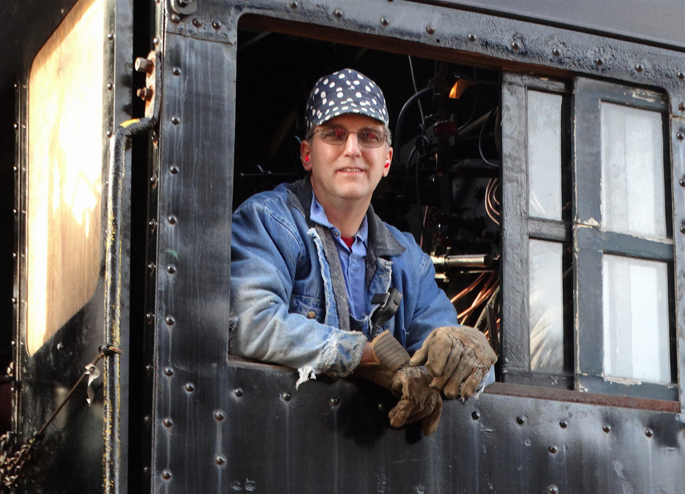Man in cab of steam locomotiveC