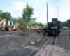 Tractor loads coal into steam locomotive