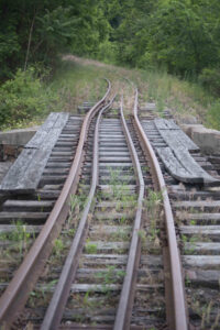 Bridge with sharply curving rails