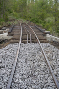 Bridge with realigned track and fresh ballast on approach