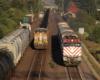 Two freight trains meet a commuter train.
