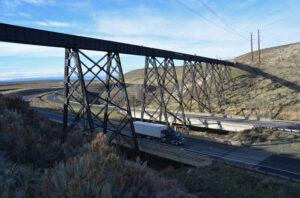 Long railroad bridge over highway