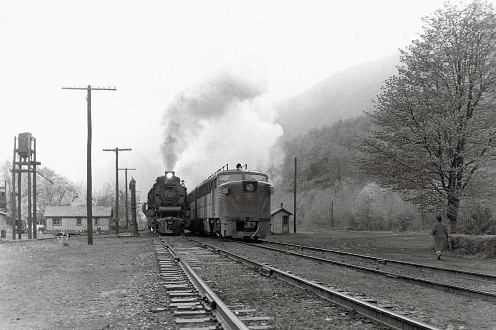 Steam and diesel locomotives park side-by-side