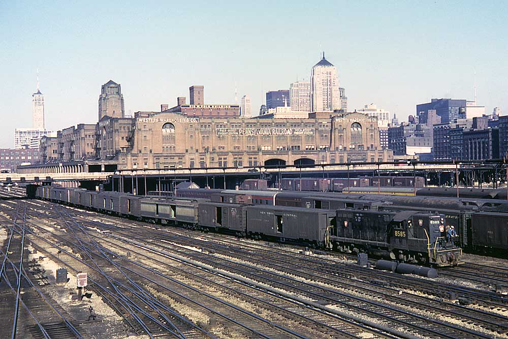 Rail yard with cars in front of large brick structure