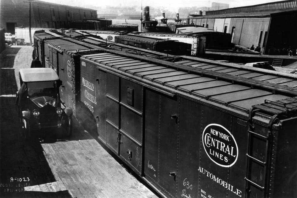 Boxcars lined up for loading along curved platform