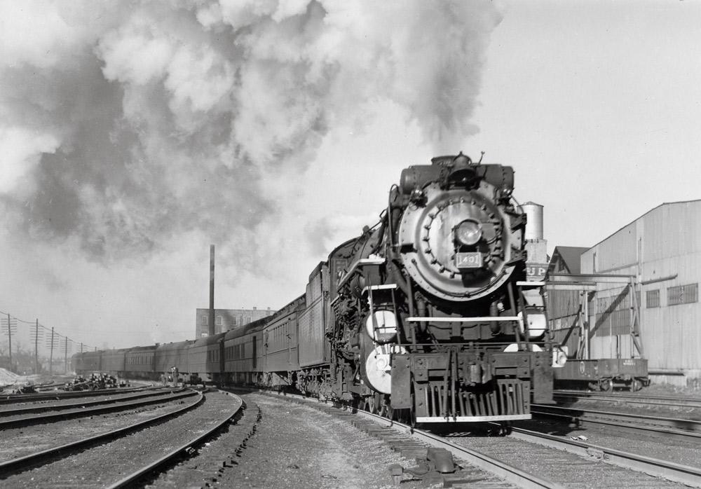Steam locomotive with passenger train