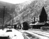 Road-switcher diesel locomotives passing station