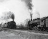 Steam locomotives on two freight trains meeting
