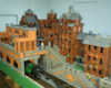 Backside of a city scene on a large-scale railway built of wooden blocks