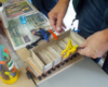 A club member clamps his flatcar project while the glue dries