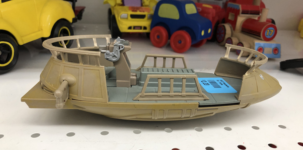 A plastic toy boat