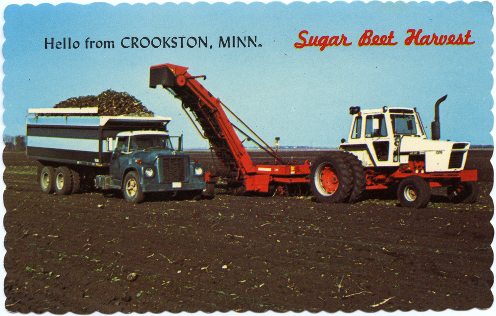 Photo of farm field with tractor, beet lifter, and beet truck.