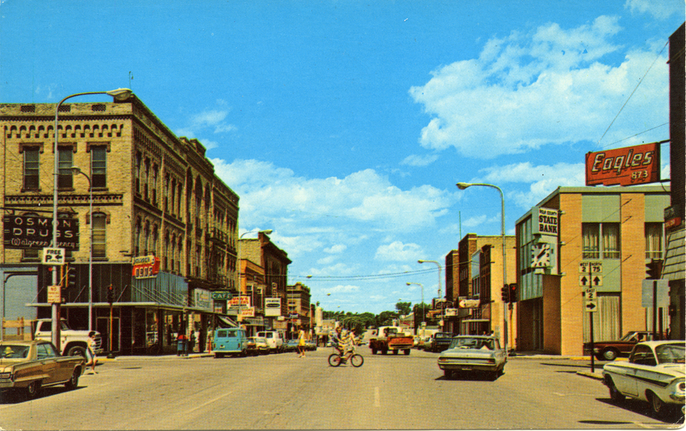 Image of downtown scene with buildings and vehicles