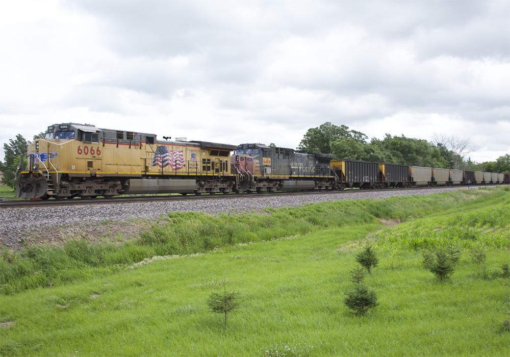 Two Union Pacific diesels lead a unit train of rotary-dump coal gondolas
