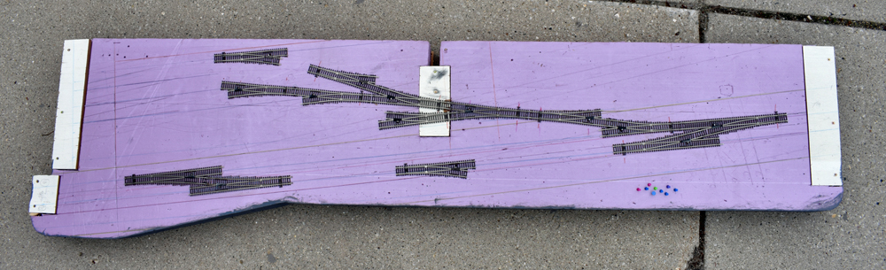 Atlas code 83 turnouts on pink extruded-foam insulation board layout surface