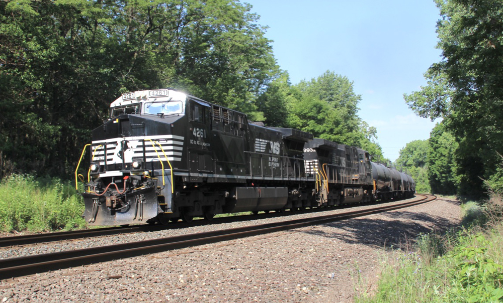 Black locomotives lead train through curve