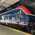 Blue and red diesel locomotive parked underground