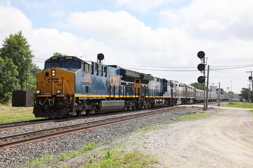Modern diesel powered passenger train between two signals