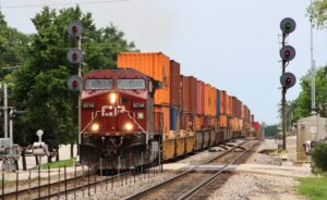 Red locomotive with freight in Illinois