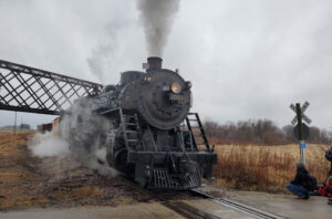 Steam locomotive under bridge in Wisconsin