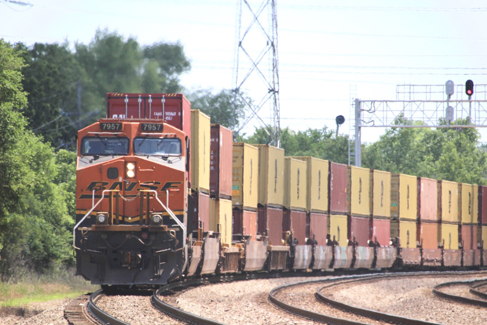 Locomotive and train of orange and yellow containers