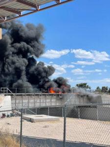 Smoke and flames on railroad bridge