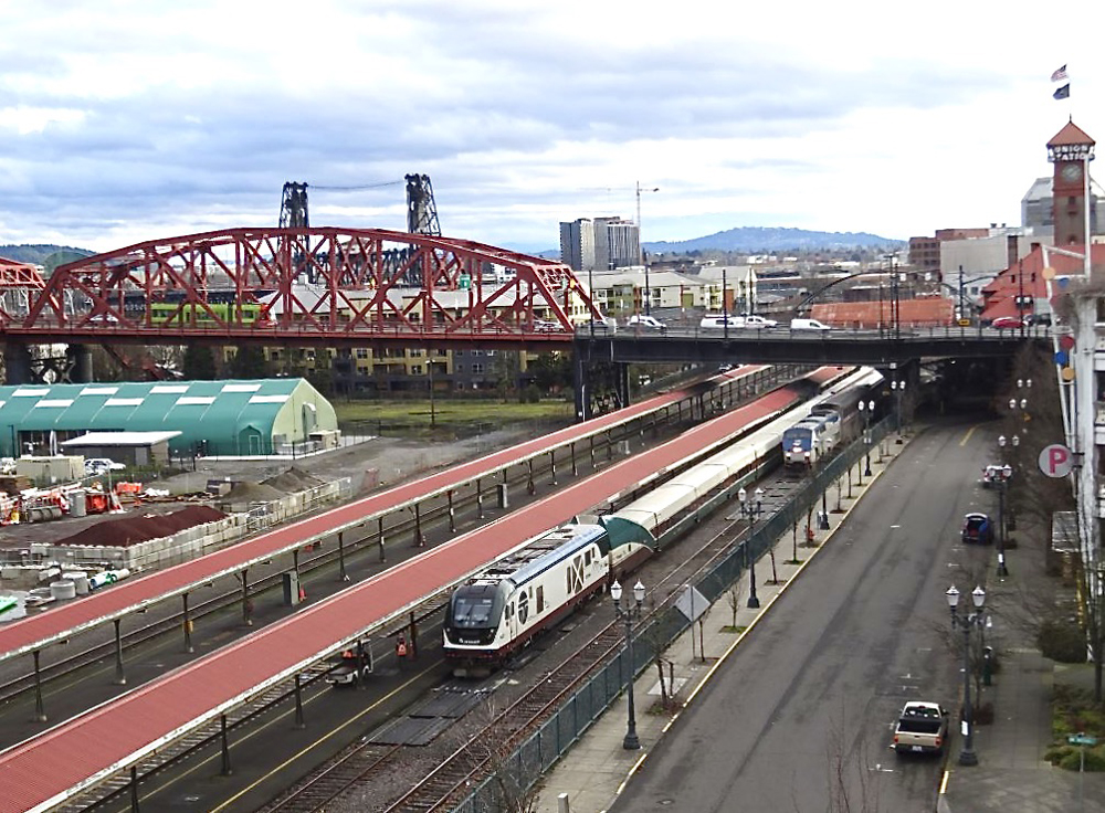 High-angle view of two trains at station