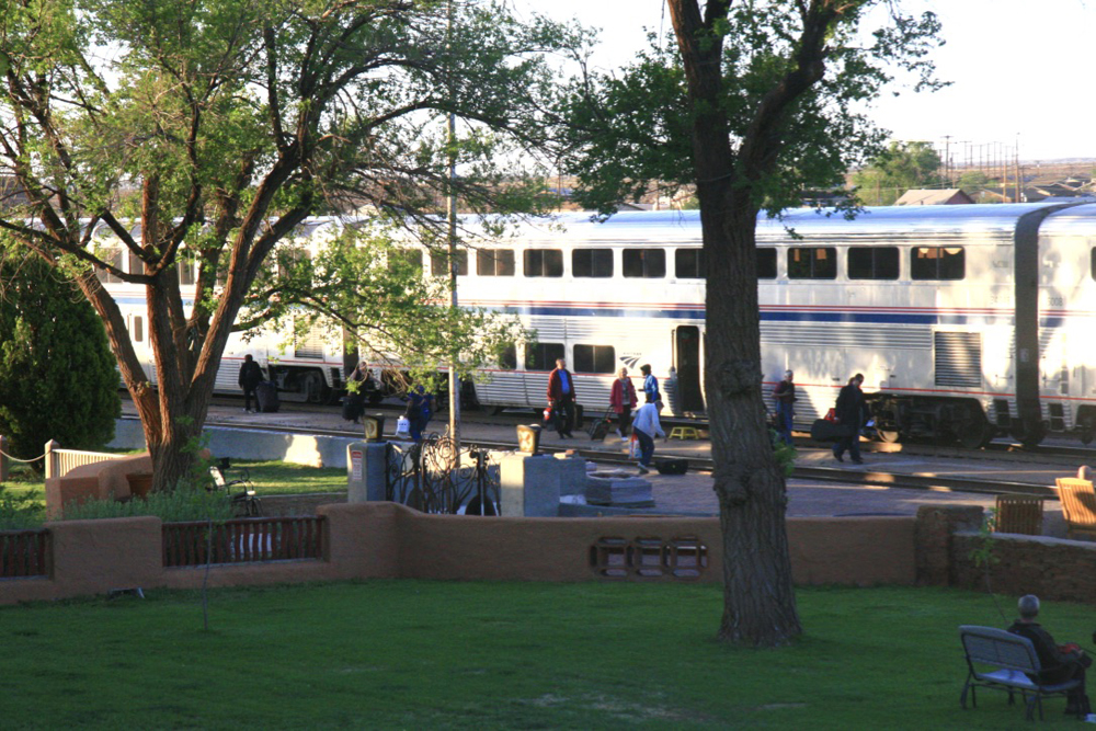 Bilevel passenter cars viewed across grounds of hotel