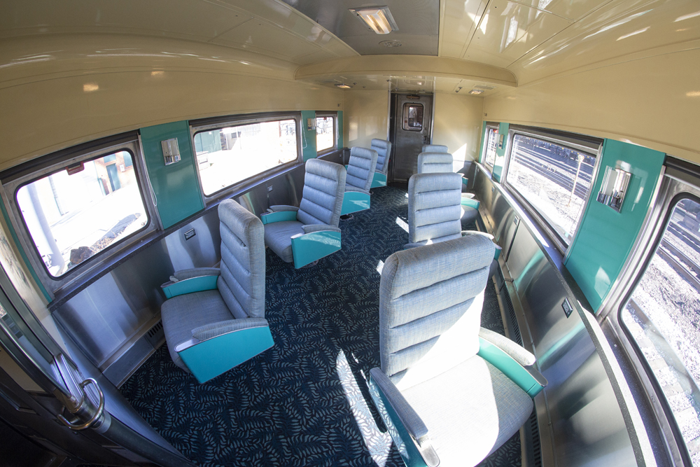 View of unoccupied lounge seats in an upscale passenger car.