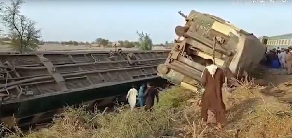 Overturned, damaged passenger cars
