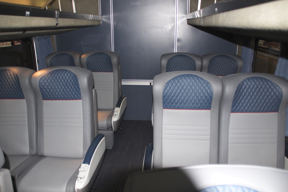 Blue, gray, and white seats in passenger car