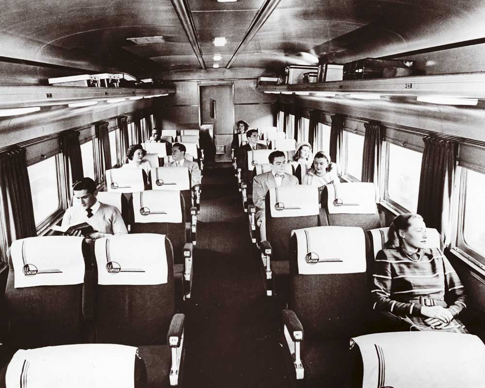 Passengers resting in coach seats